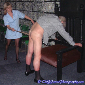 Angie canes a male bare bottom at a London spanking Party