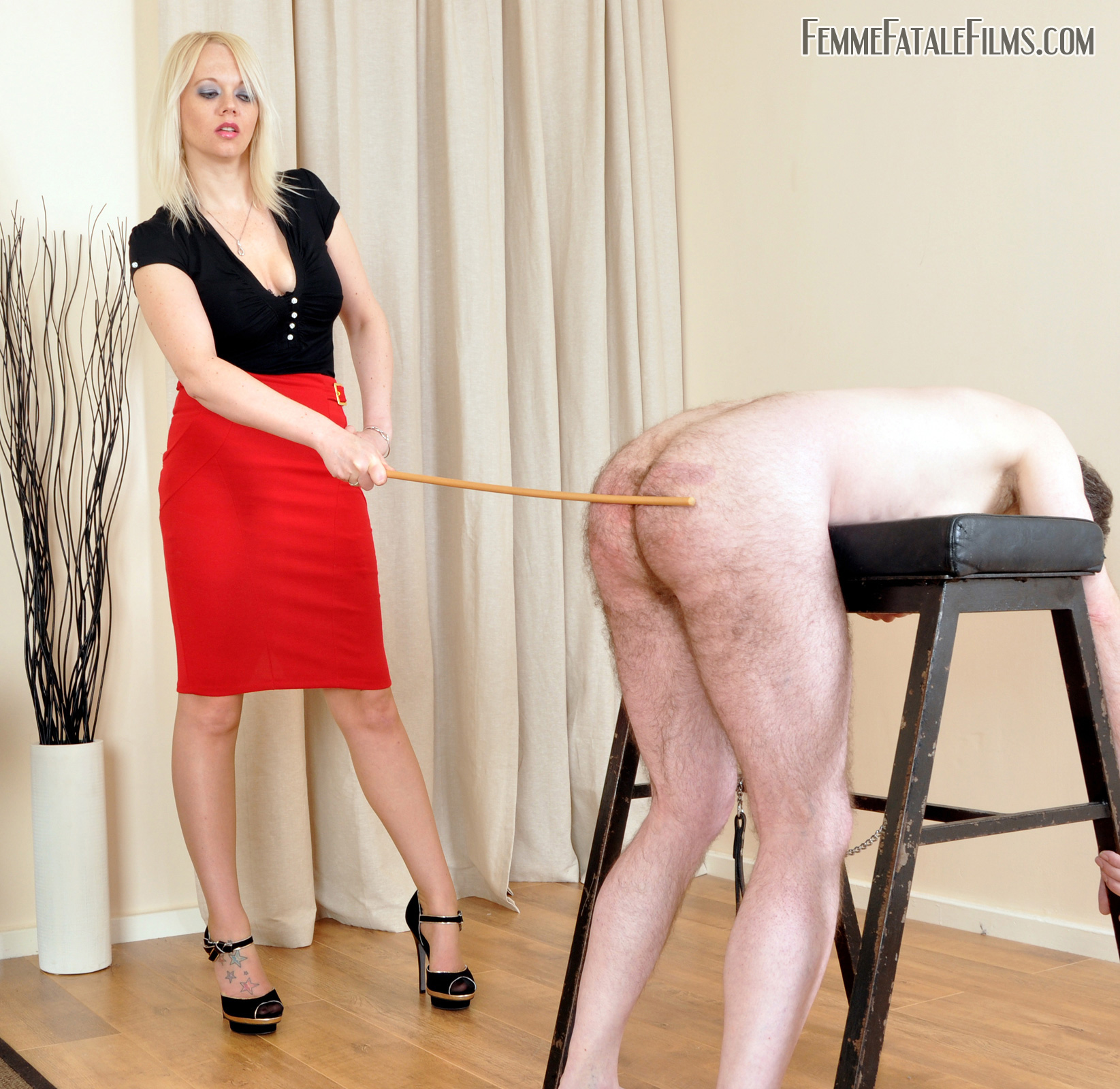 Mistress Heather Divine caning a slave