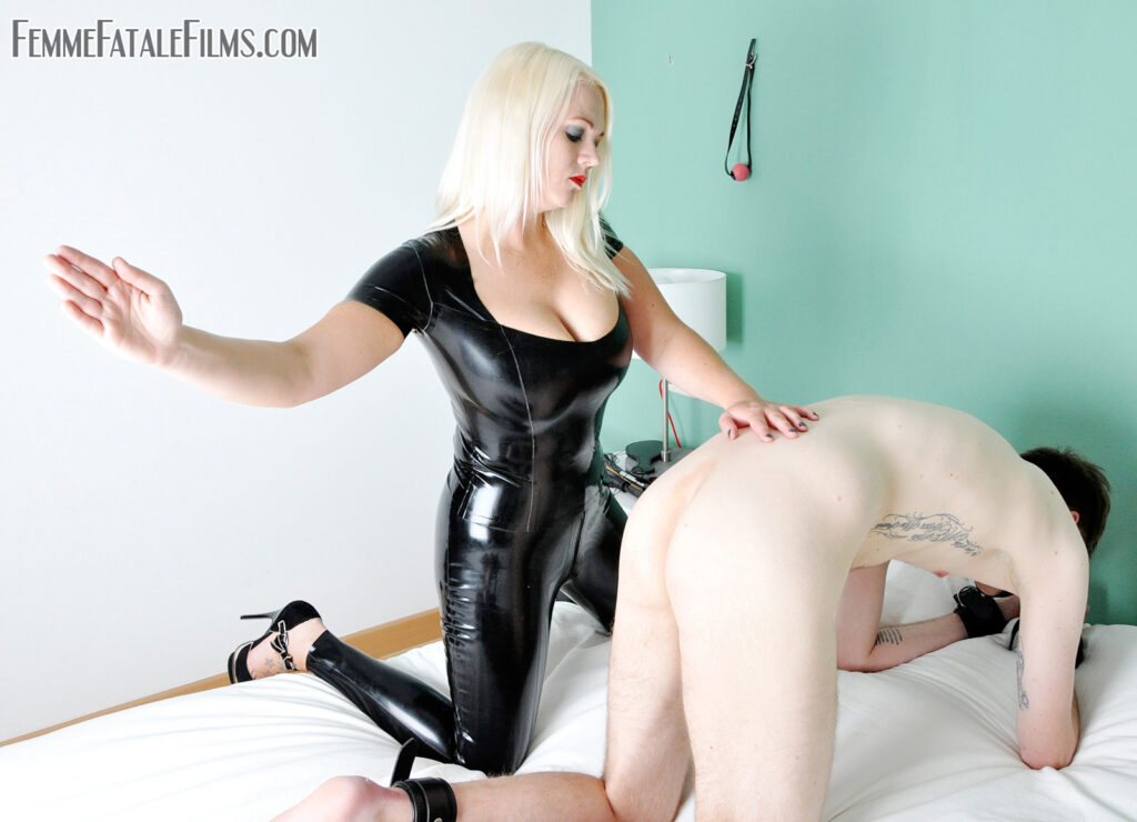 Mistress Heather's captive needs some education in the art of submission. He repeatedly misinterprets the meaning of his pathetic existence, thinking that he has some relevance, however it isn't long before he is taught exactly what his worth is, that being to be used as a beating toy for his Mistress's pleasure. Adorned in skin tight black latex, Mistress heather takes great pleasure in whipping him into shape with some extreme corporal punishment treatment.