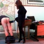 Hauled before the Headteacher after school has closed, this unruly pupil now stahnds silent, awaiting his punishment. Previous punishments had clearly not worked on this boy and the Headmistress now wants to up the ante and vows to get through to him, one way or another. Told to remove his trousers he duly does so and bends over the desk and the headmistress wastes no time in raining down a harsh spanking. Up next comes the slipper, then the paddle, and Miss doesn't hold back on either, as his flesh gets redder and the sighs louder. Next up is a severe otk spanking, but she's not satisfied. Moving him to the spanking bench, she gives him a strapping with a tawse (after some more hand spanking of course), then a final bout of hand spanking sees out this harsh session...