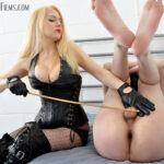 Mistress Eleise canes her slave on his balls