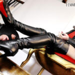 Featuring Divine Mistress Heather. This slave had taken a great deal of punishment in the preceding days to this session, so I decided it was time for a little boot worship indulgence. The soft black leather needed a good licking and he was very eager to please. The soles, the heel and my long leather adorned legs were enough to make the slave's mouth dry, but nothing that a Mistress spit kiss couldn't resolve.