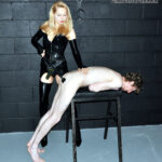 Mistress Eleise de Lacy. The slave is made to polish his Mistress' rubber stockings and latex-clad bottom. She then sets about making his arse sore inside and out with some CP and her large strap-on cock. His climax is reached with a little help from Mistress Eleise's sweet champagne.