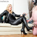 Featuring Mistress Akella. A slave with a huge boot and leather fetish, eager to please his Mistress is very easy prey for Mistress Akella... he may lick and suck her boots, but his indulgence must come at a cost! After some ingenious placement of a few vicious clamps, the slave's work is made that much more demanding.