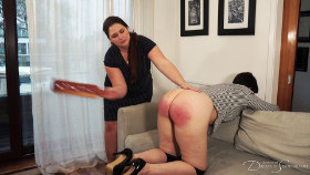 Executive Pandora Blake argues herself into a corner in the name of equal treatment: a humiliating punishment with the heavy wooden paddle from her strict boss Kelley May.