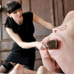 Goddess Miss Kelly exploits her slave's weakness for the hypnotic scent of her feet, using it to train him to take ever-more punishment for her. He cannot help but submit to her trampling, and suffer beneath her strap, crop, and a battering with the hairbrush.