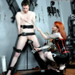 Featuring Miss Mara Mayhem. Miss Mara Mayhem's slave is strapped to the cross and used like a piece of meat - a well-tenderised piece of meat by the time she's done with him. Clamped, clawed, stretched, slapped, and spat on, the slave's suffering is intense and obvious, almost as obvious as Miss Mara's pleasure.