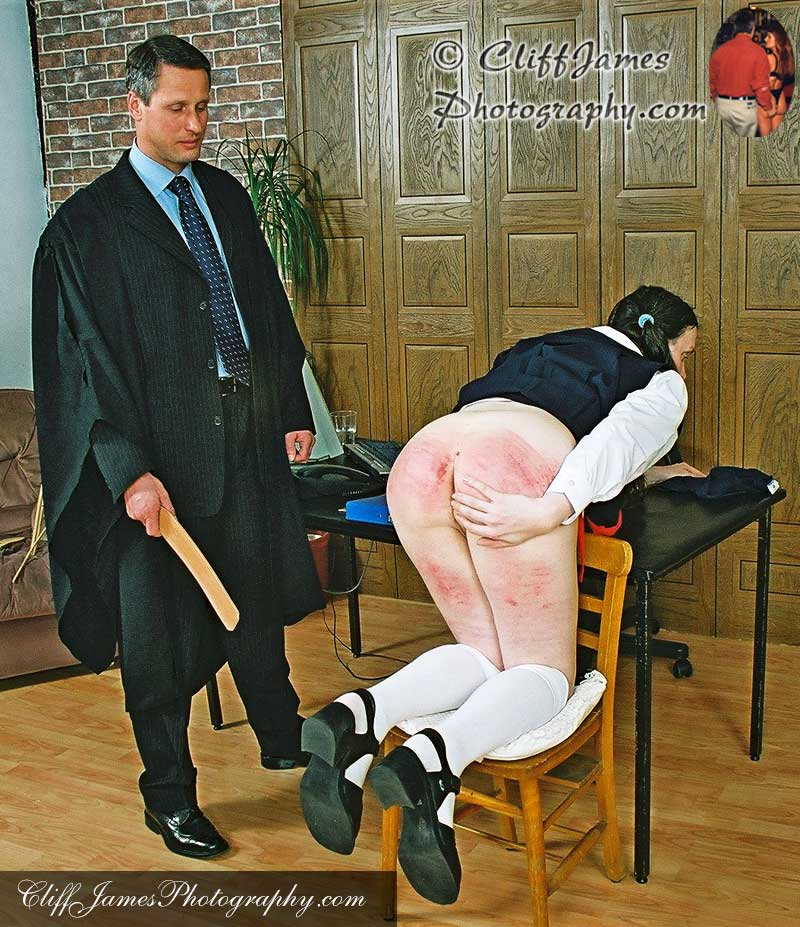 Schoolgirl JoJo gets a hard bare bottom strapping from Steve Bickers